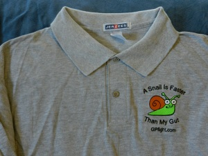 Close up of a Gray Polo with the Snail image.   Order yours at The GP Fight Store (GPfight.com)